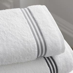 Crisp white folded bath towels