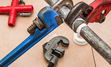 A set of tools including a plumbing wrench
