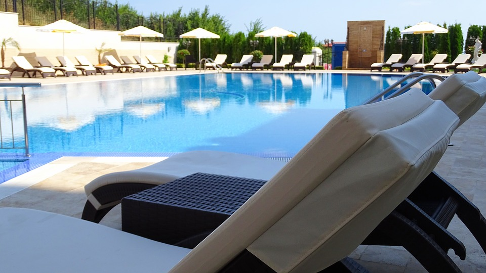 Swimming pool with chairs around