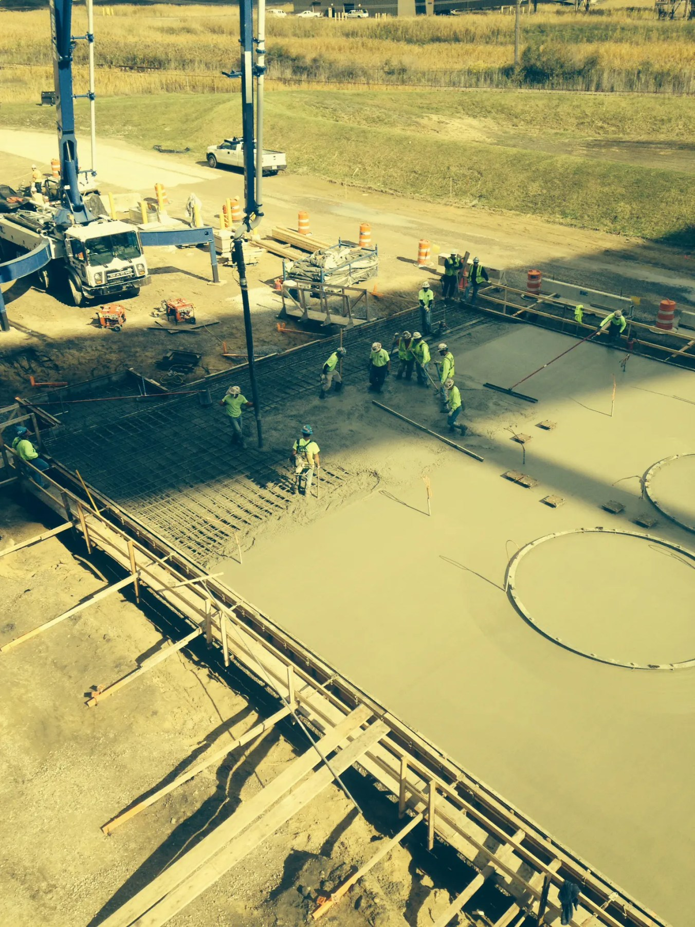 Construction workers pouring concrete at Belle River