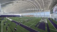 Northwestern University football players practicing on field