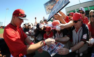 Los Angeles Angels' Mike Trout signs autographs prior to a spring baseball game against the Los Angeles Dodgers at Tempi Diablo Stadium on Friday, Feb. March 1, 2013 in Tempe, Arizona. Angels won 16-8.  (Keith Birmingham Pasadena Star-News)