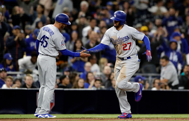 The Dodgers' Matt Kemp drops his bat as he watches the flight of his three-run home run during the third inning of Monday's game against the Padres in San Diego. The Dodgers won 10-3. (Photo by Denis Poroy/Getty Images)