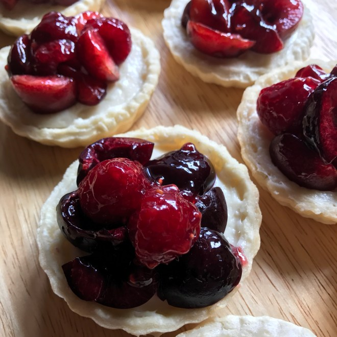 Miniature tarts with raspberries and cherries