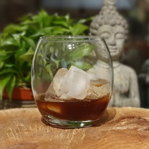 Sticky Chai Vodka in a glass with ice