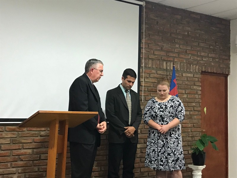 Missionary Steve Thornton praying for Pastor Hernan and his wife Kristina.