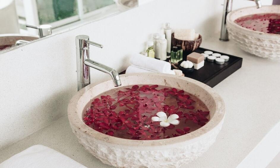 a stone basin sink bathroom