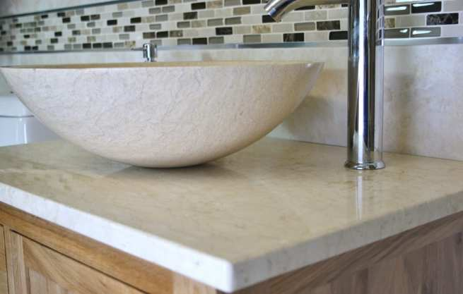 Close-up Side View of Cream Marble Basin on Cream Marble Top Vanity Unit
