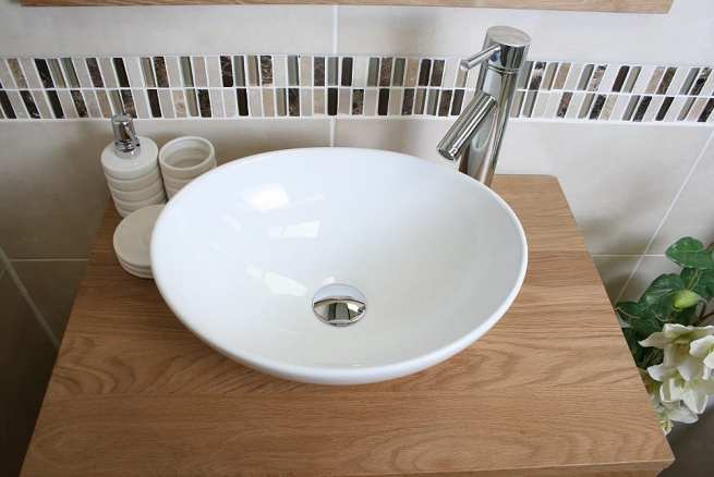 Above View of Oval White Ceramic Basin on Single Oak Top Vanity Unit