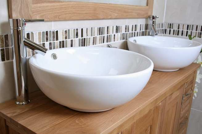 Side Close-up of Two Round White Ceramic Basins on Oak Top Vanity Unit