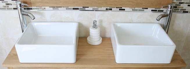 Close-Up of White Square Ceramic Basins on Large Oak Top Vanity Unit