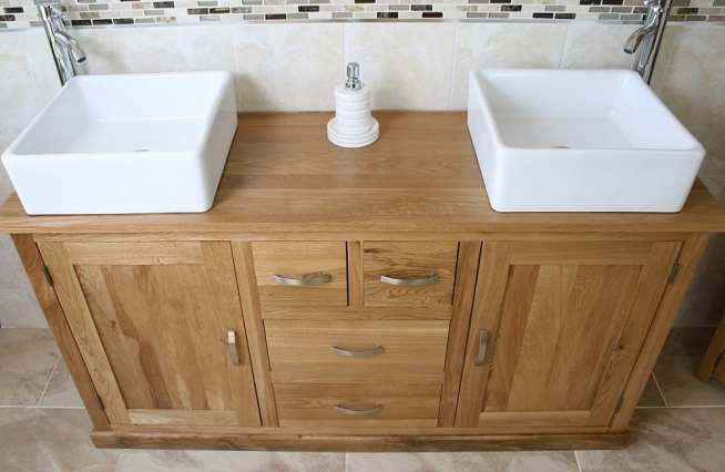Above Close-Up Side View of White Ceramic Oval Basins on Large Oak Vanity Unit with Oak Top Finish