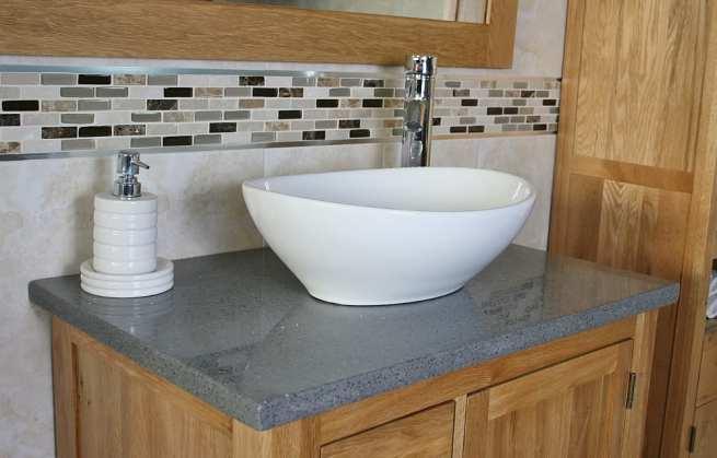 Close Up View of Oval White Ceramic Basin on Grey Quartz Top Vanity Unit