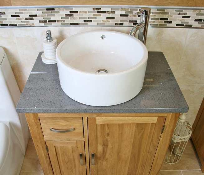 Above Close Up of Round White Ceramic Basin on Grey Quartz Top Vanity Unit