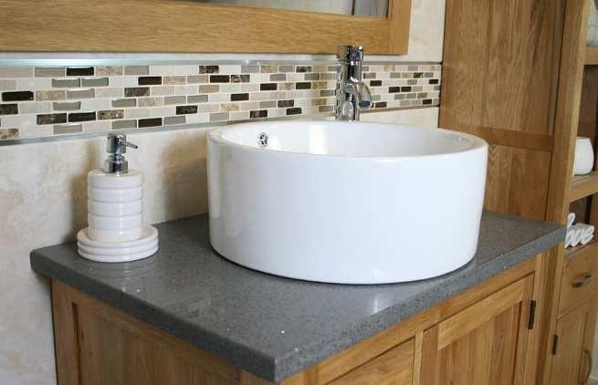 Side View - White Round Ceramic Basin on Grey Quartz Top