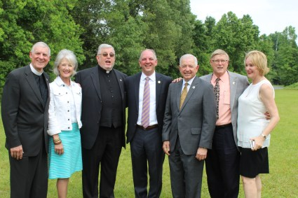 """From the left: The Rev. Dr. Rodney Wood and wife Becky, Father Jeff Bayhi, Gov. John Bel Edwards, Sen. Ronnie Johns, Bobby Gaston, PhD., and Suzan Gaston, PhD. Colonel Mike Edmonson, Superintendent of the State Police and wife, Suzanne Edmonson were not able to attend, but they were members of """"The Group of Eight."""""""