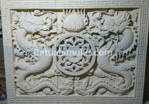 Relief Batu Putih Motif Naga
