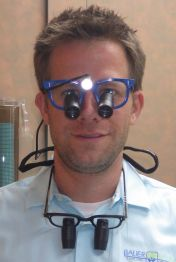Dr. Bryan wearing dental loupes for magnification in dentistry