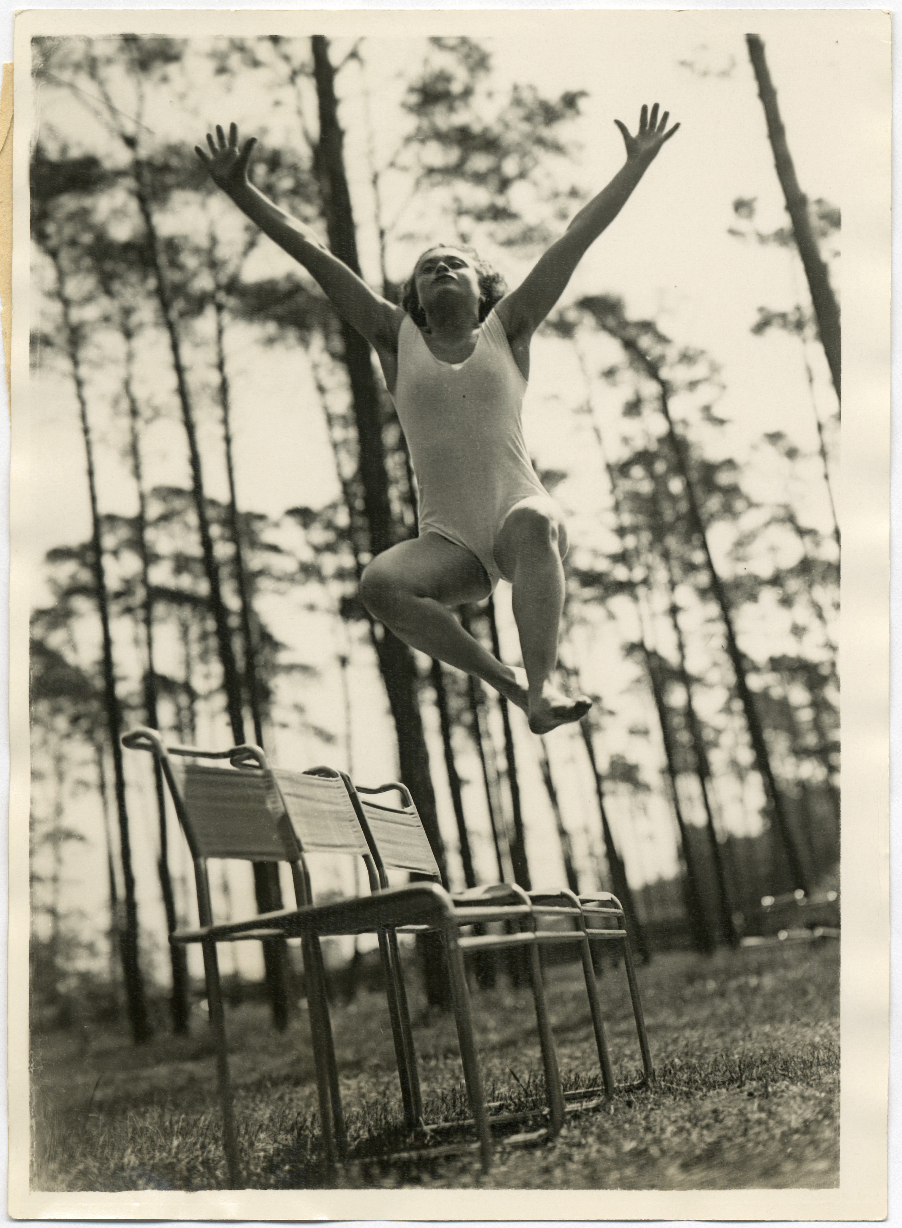 Pacific & Atlantic Photo (photo), Marcel Breuer (chair design), Gymnastics in the forest: exemplary jump over 3 chairs, after 1927 / Bauhaus-Archiv Berlin
