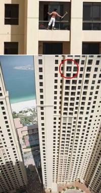 Fensterputzer ohne Sicherung an der Fassade eines Hochhauses