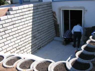 Herstellen eines nachträglichen Kellerzuganges mit Terrasse und Außenanlagen
