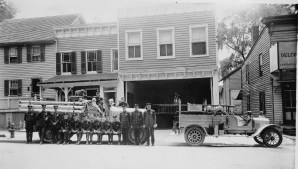 PHOTO TAKEN IN 1965 SHOWS THE BUILDING THAT WAS THE COURTLAND STREET FIRE STATION. THE DOUBLE SWINGING DOORS HAVE BEEN REPLACED WITH A ROLL-UP DOOR.