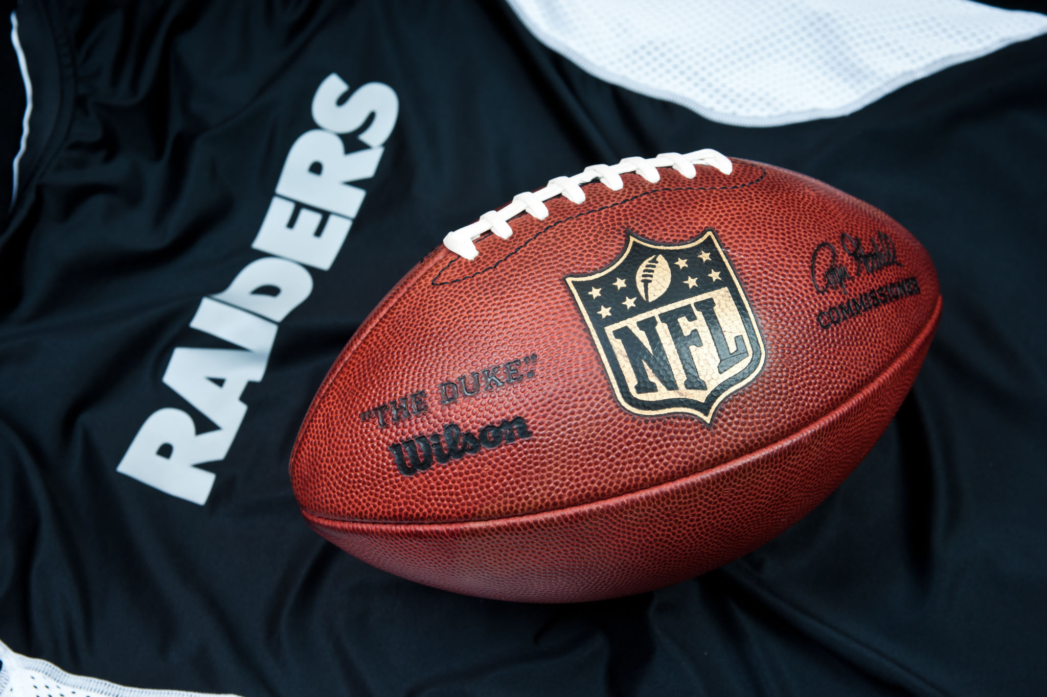 Oakland Raiders jersey and NFL branded football