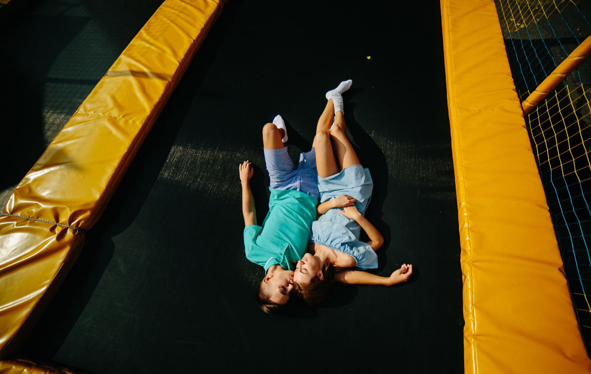 couple lying on a trampoline together