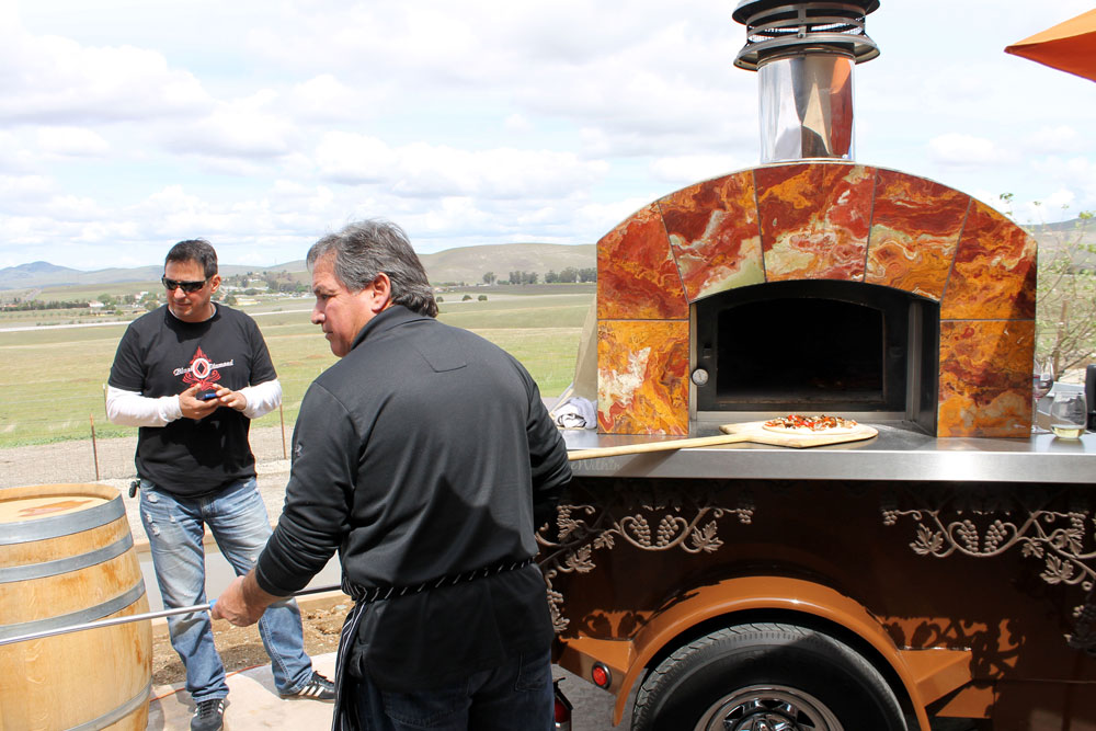 Pizza baking in oven at Barrels, Bottles & Brews in Livermore.