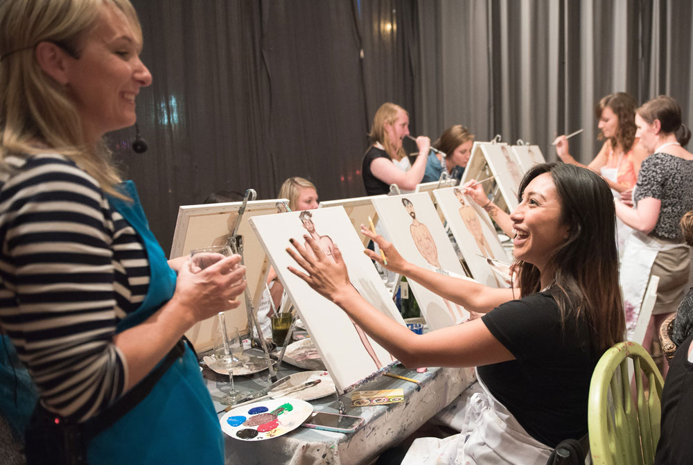 Friends painting at a Girls' Night Out in the South Bay.