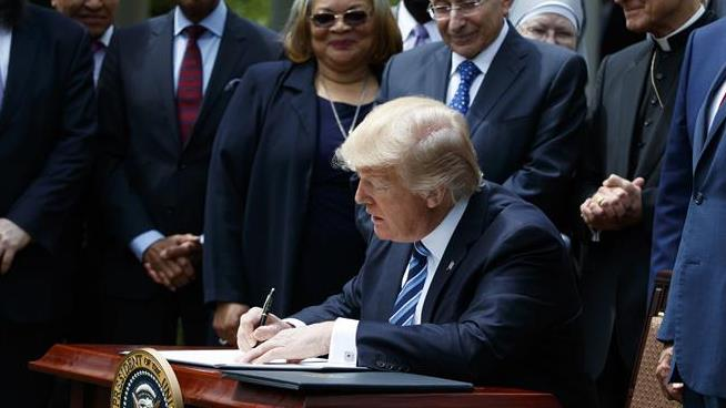 Trump signs executive order permitting lawful discrimination against gay people