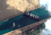 Efforts to dislodge stranded Suez Canal container ship intensify as backlog grows 3