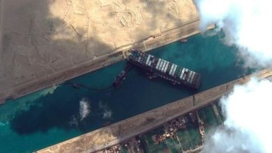 Efforts to dislodge stranded Suez Canal container ship intensify as backlog grows 26