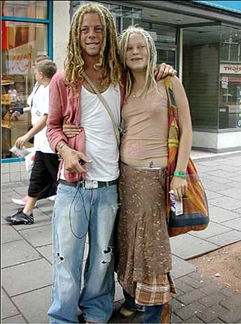 Couple with relaxed, 'hippy' style & dreadlocks