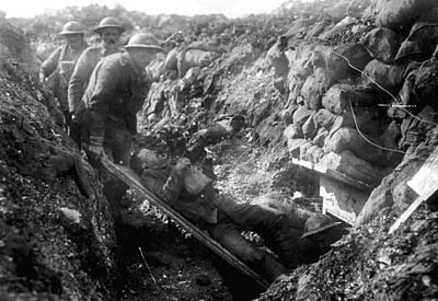 A soldier evacuated from the battlefront on a stretcher during WW1 - Image courtesy - bbc.co.uk. Click for larger image.