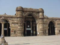 Gujurat mosque, a one-storey stone building with arches along its facade