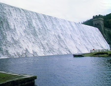Water flowing over Derwent Dam in Derbyshire