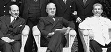 Attlee, Truman and Stalin sitting at the Potsdam Conference