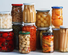 A selection of pickled and preserved foods in glass jars.