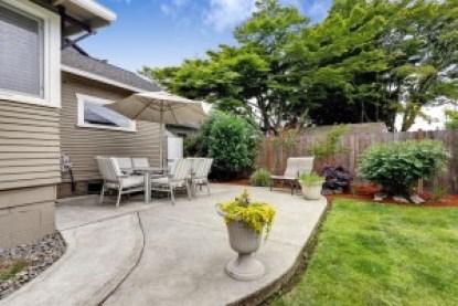 Backyard Concrete Patio by Better Built Construction.