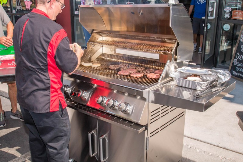 Chef Phillip Dell grilling hamburgers on a Bonfire Grill at the Back to Basics Grilling Class at BBQ Concepts of Las Vegas, Nevada