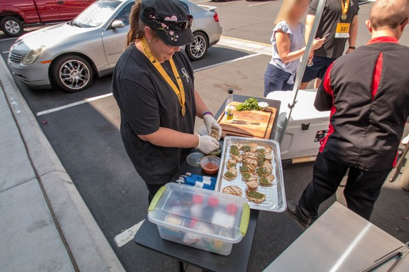 One of Chef Dell's students helping out with the Vegetable Bruschetta at our Back to Basics Grilling Class - Saturday, September 16th 2017
