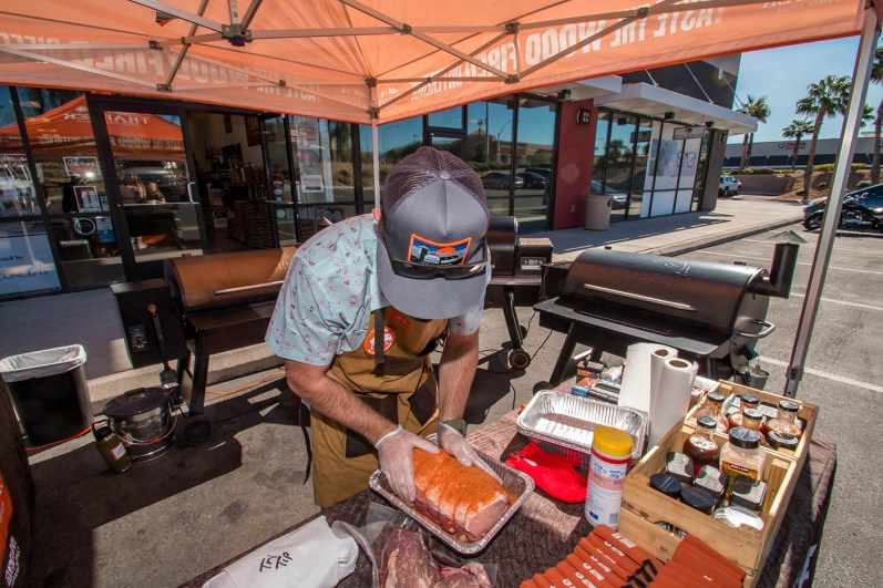 Taylor Prepping Meat Before Smoking - Traeger Demo Day at BBQ Concepts