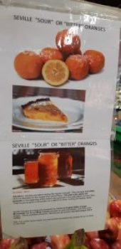 Italian Centre poster above bin of Seville oranges