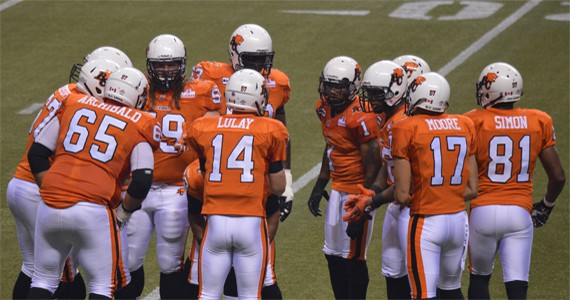 Travis Lulay huddles with the offence.