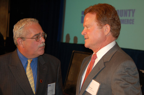 PRIOR TO MONDAY'S DEBATE sponsored by the Fairfax County Chamber of Commerce, the two candidates vying for the U.S. Senate post on the ballot in November talked it up with friends. Fairfax County Board chair Gerry Connolly (left) chats with Democrat nominee for the U.S. Senate, James Webb. (News-Press photo)