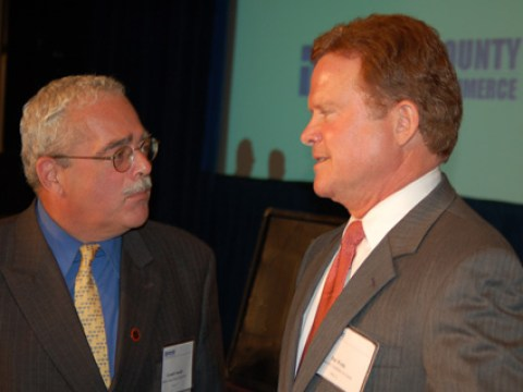 U.S. SENATOR JAMES WEBB (left), speaking at a Northern Virginia fundraiser last week, gave tremendous credit to former U.S. Congresswoman Leslie Byrne (right) for convincing him to run in the Democratic primary just one year ago. The rest is history. Both Webb and Byrne are from Falls Church. (News-Press photo)