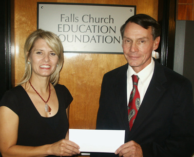 CHRIS WOLLENBERG presents the Falls Church Education Foundation's Donna Englander with a $100,000 check for a scholarship endowment.