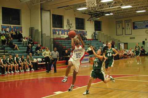 NICOLE HARRISON (15) and the Lady Statesmen of Marshall cruised past Langley to push their winning streak to seven games. (NEWS-PRESS PHOTO)