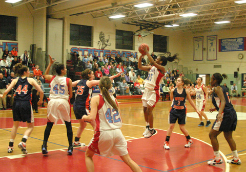 MARSHALL'S NICOLE HARRISON shoots during the Statesmen's 52-43 victory over West Springfield Tuesday night. Marshall next faces Oakton Thursday. (PHOTO: NEWS-PRESS)